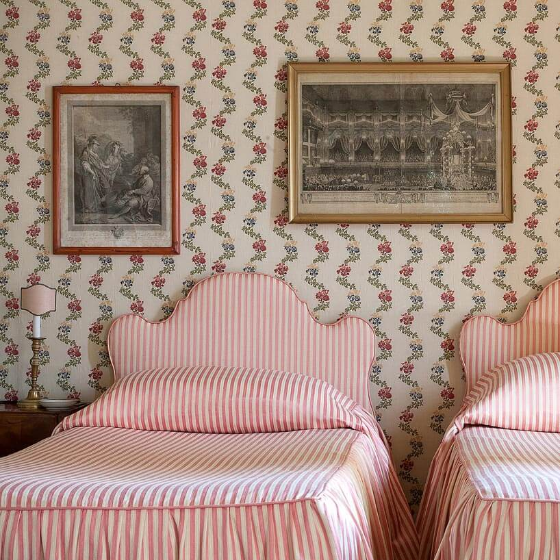 Striped linens on beds within in Villa Sola Cabiati on Hello Lovely